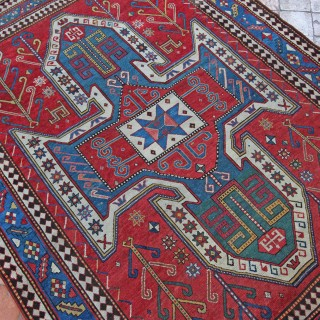 Antique Sewan Kazak rug