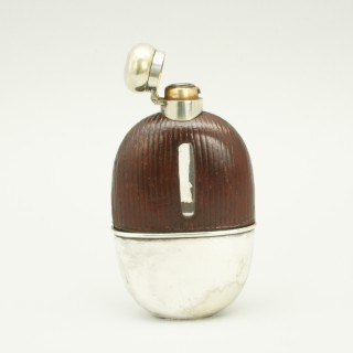 Silver Plated Hip Flask with Leather Cover.