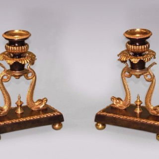 A Pair of early 19th Century Regency period bronze & ormolu Candlesticks with dolphins.