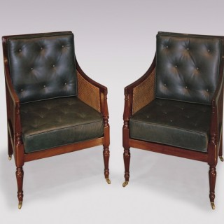 A near pair of 19th Century mahogany Library Bergere Chairs.