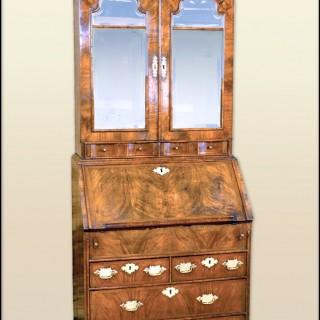 A small rare Queen Anne walnut bureau cabinet