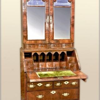 A small rare Queen Anne walnut bureau cabinet