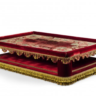 A red Velvet and Velvet Applique Banquette