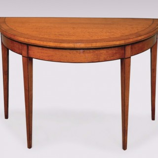 A Sheraton period satinwood Card Table.
