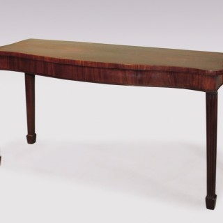 A George III period mahogany Serpentine Serving Table.