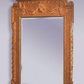 A George II period giltwood Looking Glass.