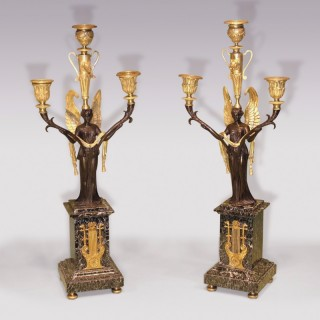 Pair of ormolu and green marble Candelabra.