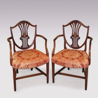 A Pair of late 18th Century Hepplewhite period mahogany Armchairs.