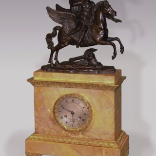 An early 19th Century French Bronze, Ormolu & Sienna Marble Mantel Clock.