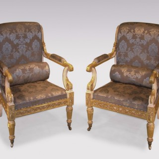 Impressive pair of Regency period white painted and carved giltwood Armchairs.