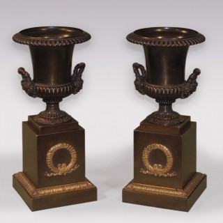 A pair of early 19th Century bronze and ormolu Campana shaped Urns.