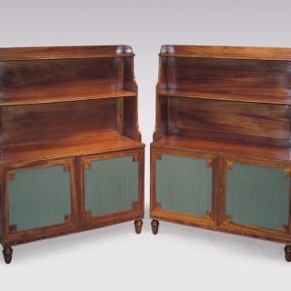 A pair of Regency period figured mahogany Waterfall Bookshelves.
