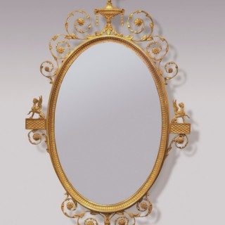 A fine 19th Century Adam style giltwood oval Mirror.