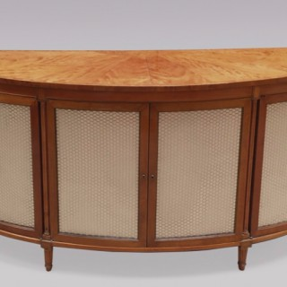 A George III period semi-elliptical satinwood Cabinet.