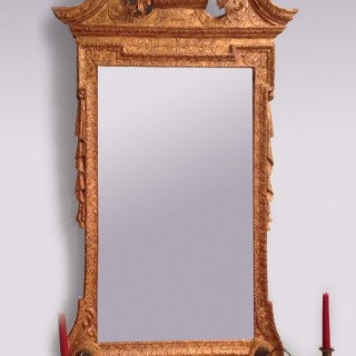 An early 18th Century George II period gilt gesso Mirror.