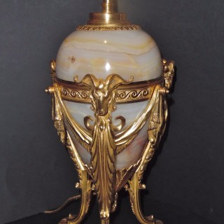 A French ormolu mounted onyx single lamp