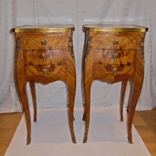 A pair of Louis XV style marquetry bedside tables