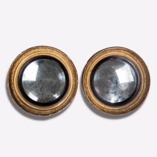Pair of gilded circular convex mirrors from the Captain's cabin of HMS Blanch, the Battle of Copenhagen