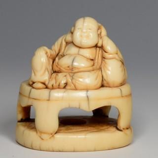 CHARMING JAPANESE EDO PERIOD IVORY NETSUKE DEPICTING HOTEI - GOD OF GOOD FORTUNE