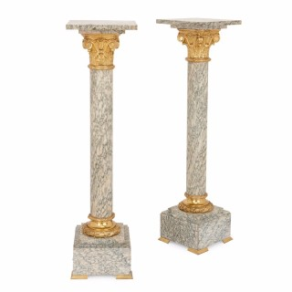 Pair of Neoclassical style gilt bronze mounted marble pedestals