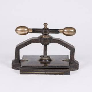 A brass and iron Victorian bookbinders press.