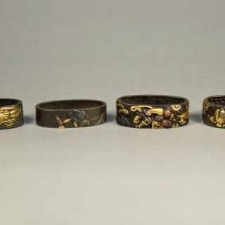 A NICE GROUP OF JAPANESE EDO PERIOD MIXED METAL FUCHI (SWORD FITTINGS)