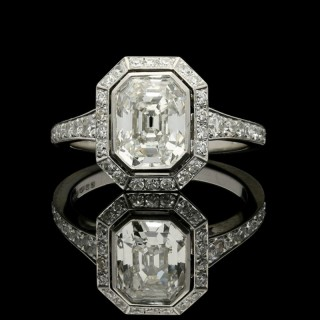 Hancocks Stunning Vintage Emerald-cut Diamond and Platinum ring with a Diamond-set halo and shoulders