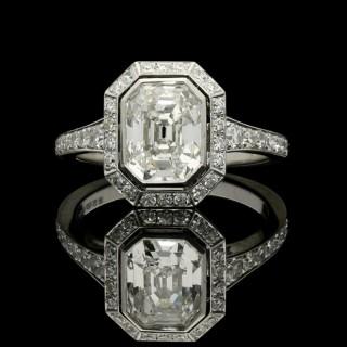 Hancocks Stunning Vintage Emerald-cut Diamond and Platinum ring with a Diamond-set halo and shoulders