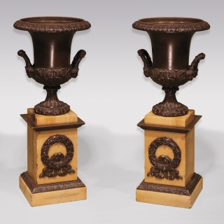 A pair of early 19th Century bronze campana-shaped Urns.