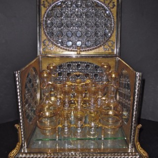 A rare and impressive French bronze mounted and crystal cut cave a liqueur