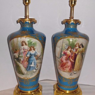 A pair of French porcelain lamps
