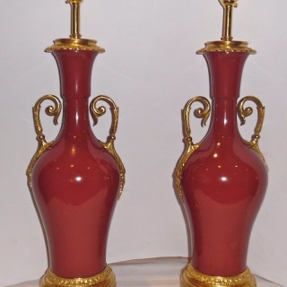 A pair of French ormolu mounted porcelain lamps