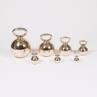 A set of 7 bronze imperial globe standard weights for the City of Exeter.