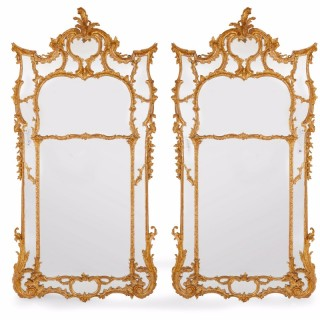 Pair of English antique giltwood wall mirrors in the Rococo style