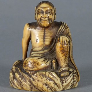 JAPANESE EDO PERIOD IVORY NETSUKE - SEATED SENNIN - SIGNED