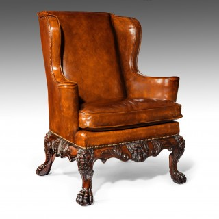 A Handsome Late Victorian Leather Carved Wing Chair