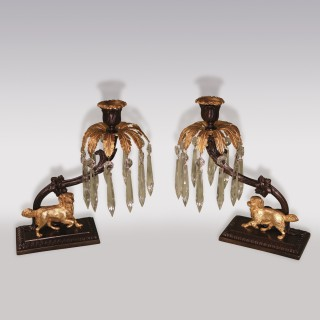 A pair of early 19th Century bronze and ormolu Lustre Candlesticks.