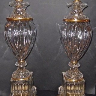 A pair of French ormolu mounted crystal lamps