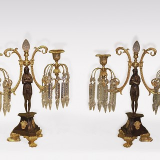A Pair of early 19th Century bronze & ormolu 2-light Lustre Candlesticks.