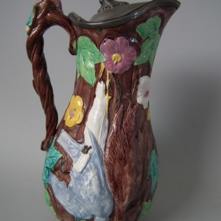 Large Majolica game pitcher with pewter lid