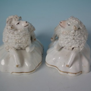 Pair Staffordshire porcellaneous sheep figures
