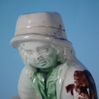 Staffordshire creamware boy on barrel figure