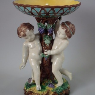 Majolica putti with grapes compote