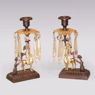 A pair of 19th Century bronze and ormolu Stag Lustre Candlesticks.