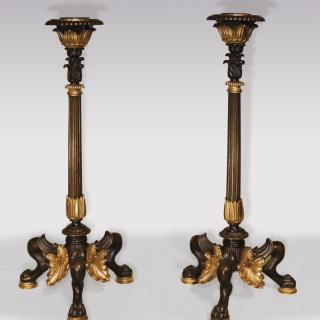A pair of mid 19th Century bronze and ormolu Pompeian Candlesticks.