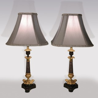 A pair of early 19th Century bronze and ormolu Candlestick Lamps.