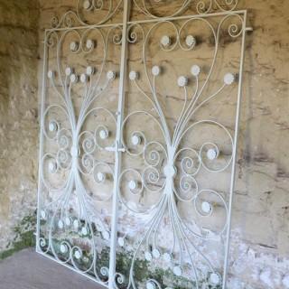 A pair of wrought iron garden gates