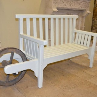 A painted wooden 'wheelbarrow seat'