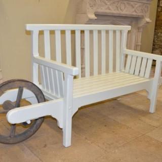 A painted wooden 'wheelbarrow seat'
