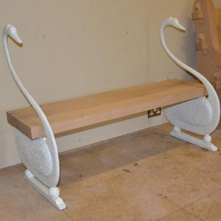 A cast iron swan bench